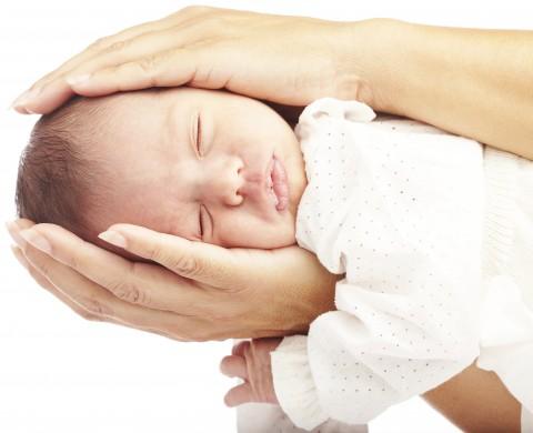 Cranial Osteopathy: hands holding newborn